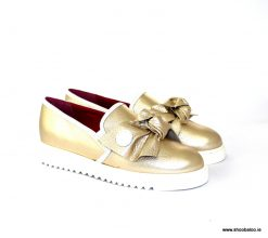 Le Babe gold sneaker with bow